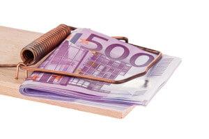 Kredit-Geldscheine in einer Mausefalle